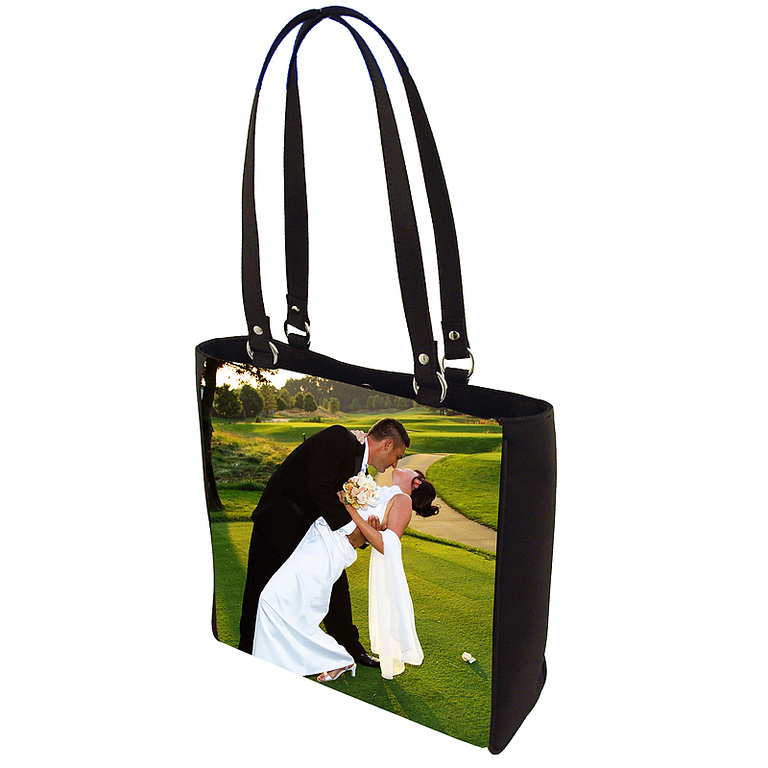 """Creel Bag<br /> <br /> Magnetic snap closure.<br /> Dimensions: 12x11x4<br /> Interior zipper pocket, cell phone pocket and mirror pocket.<br /> 0.75""""wide X 24"""" long handles with nickel ring hardware."""