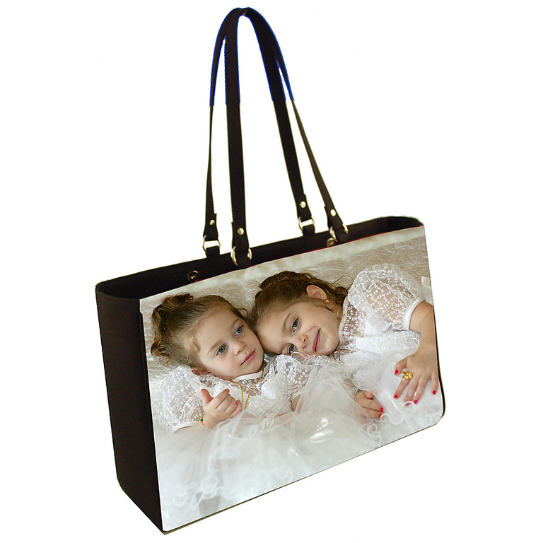 """Photographer's Tote<br /> <br /> Magnetic snap closure.<br /> Dimensions: 18x12x5 at base.<br /> Interior zipper pocket, cell phone pocket and mirror pocket.<br /> 0.75"""" wide X 24"""" long handles with nickel ring hardware."""