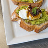 Eggs with onion relish on avacado sour dough taost.