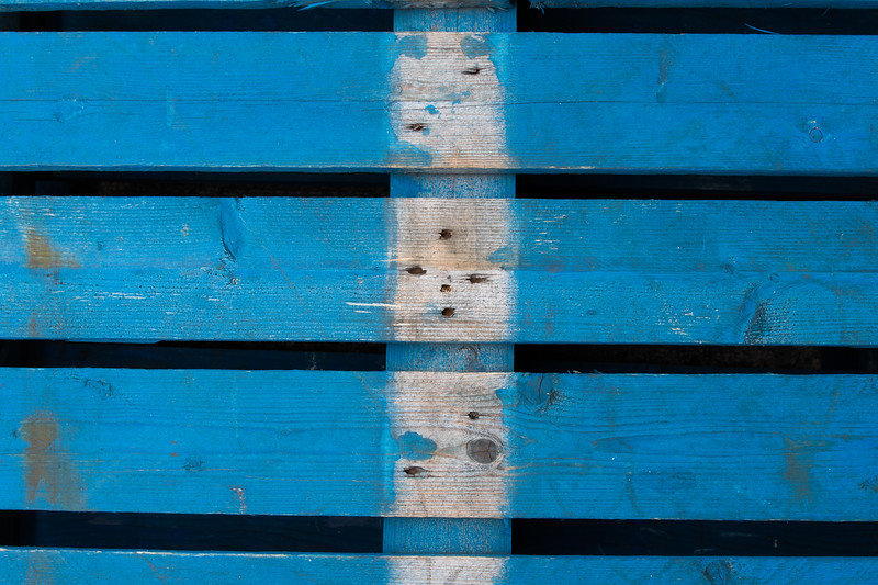 A wodden pallete painted blue.  Close up shot.