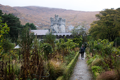 Woman on holiday taking pictures at Glenveagh Castle.