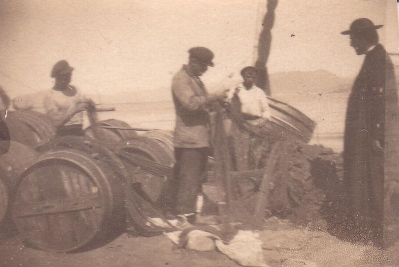 Sestri Levante; fishermen mending their nets with a priest.<br /> <br /> Sestri Levante; i pescatori rammendano le reti in compagnia di un sacerdote.