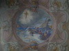 Fresco on the roof of the church in front of the Santo Cristo's altar; sailors caught by a storm prey the Santo Cristo and are saved.<br /> <br /> Un affresco sul soffitto della navata di fronte all'altare del Santo Cristo rappresenta alcuni marinai che sorpresi da una mareggiata si rivolgono al Santo Cristo ed ottengono la salvezza.