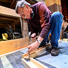 "KRISTOPHER RADDER — BRATTLEBORO REFORMER<br /> Chip O'Brien makes some cuts on the table saw as he works on the set of ""Cabaret, The Musical"" at The Bellows Falls Opera House on Thursday, Feb. 13, 2020."