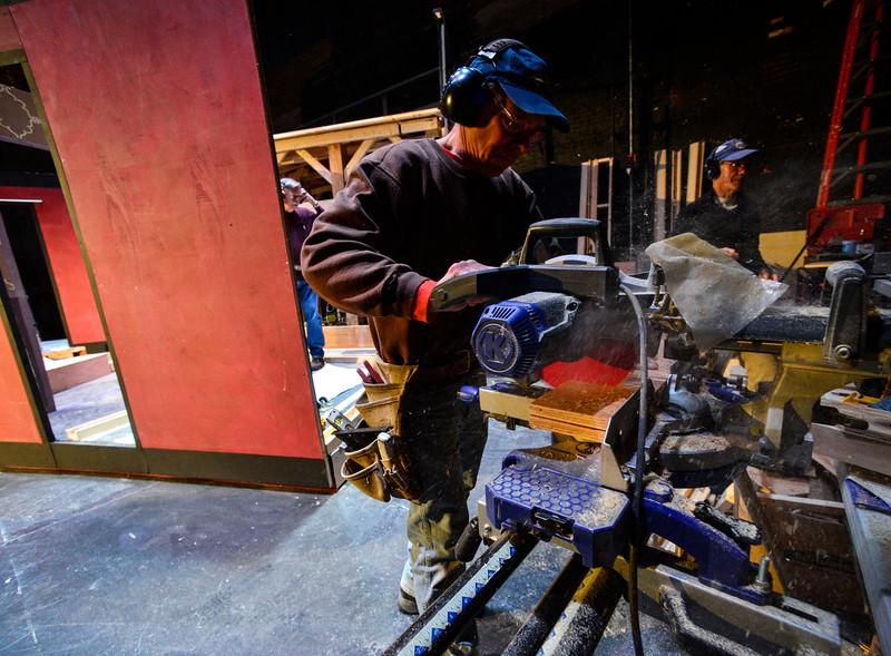 """KRISTOPHER RADDER — BRATTLEBORO REFORMER<br /> Bill Doran works on edging for the set of """"Cabaret, The Musical"""" at The Bellows Falls Opera House on Thursday, Feb. 13, 2020."""