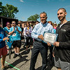 Mayor Dean Mazzarella presents Chris Cote, owner of Set the Tone gym, with a certificate during the ribbon cutting and 5K on Saturday, May 27, 2017 in Leominster. SENTINEL & ENTERPRISE / Ashley Green