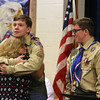 Twin brothers Adam, left, hugging his mother Laura Chidester, and Benjamin Chidester, right, of Townsend, are awarded the rank of Eagle Scout, following their five older brothers, at a ceremony at Littleton Chapel in Littleton. (SUN/Julia Malakie)