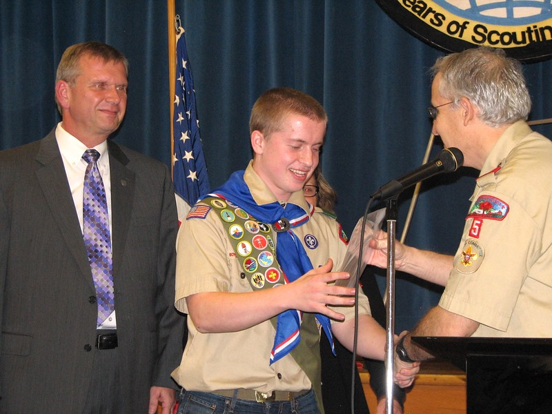 Aaron Chidester, center, becomes an Eagle Scout at his Court of Honor on Nov. 8, 2013. Aaron, now 20, was the fifth of his brothers to do so. (Photo courtesy of Laura Chidester)