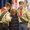 Twin brothers Benjamin, left, and Adam Chidester, 18, of Townsend, fasten the pins that Eagle Scout mothers get, on their mother Laura Chidester, as they are awarded Eagle Scout rank at a ceremony in Littleton. (SUN/Julia Malakie)