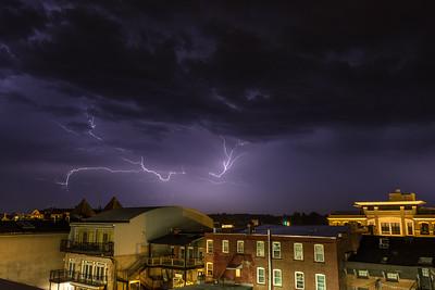 Lightning streaks across the sky over Downtown Saratoga Springs