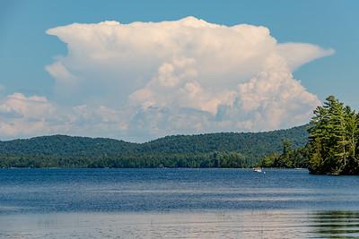 Towering cumulonimbus cloud over Raquette Lake, NY