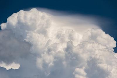 Pileus atop a cumulus cloud