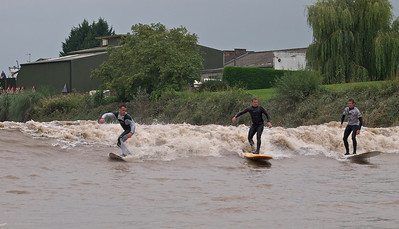 Russel Winter (left), Steve King (middle) and Nathan riding a good section of the bore wave. Love the weeping willow backdrop here.