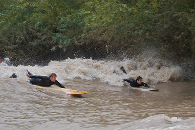 Sergio Laus (right) and Steve King working through surf.