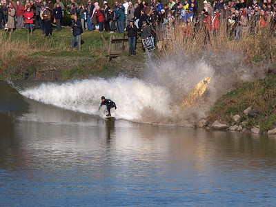 Quite easily the most dramatic Severn Bore photo I have captured. I like to position myself on the opposite side to all the crowds for two reasons. It is quieter, easier to get a good spot and possible to get a full frontal of the wave and rider. I watched these two guys pick up the wave when it formed and ride it until one of them got caught too close on the bank. He got slammed into the rocks and his board went flying, as you can see. I also love the crowd reaction behind, lapping it all up with cameras clicking away. Olympus E1, 90-250mm, F13, 1/250s.
