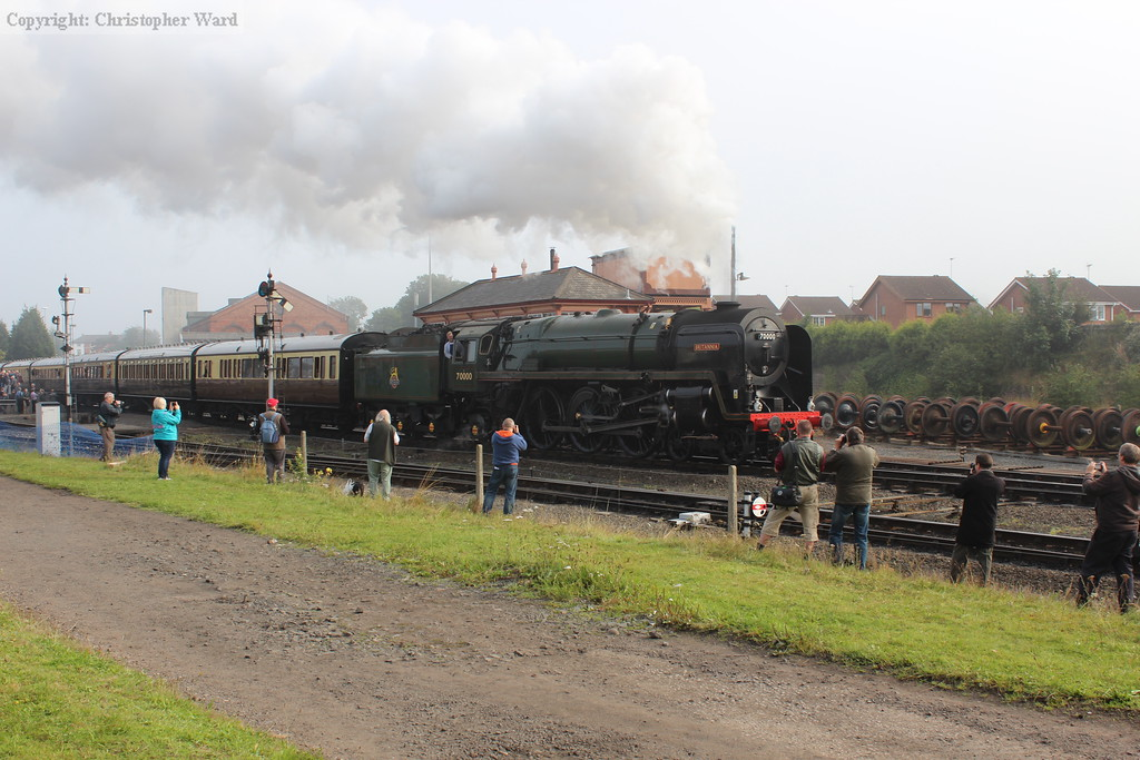 Britannia pulls away from the station with the GWR stock