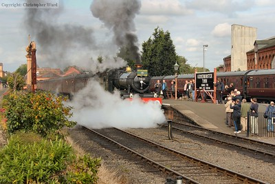 With a blast of steam, 7812 pulls away