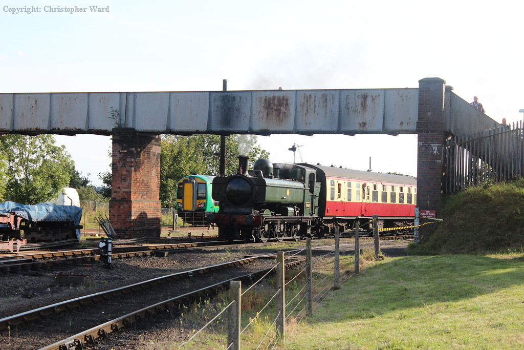 A class 172 disappears toward Worcester as 3650 rolls in