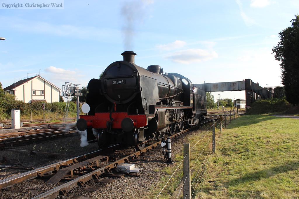 31806 moves forward toward the platforms