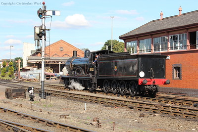 The vintage 4-4-0 rolls past the signalbox