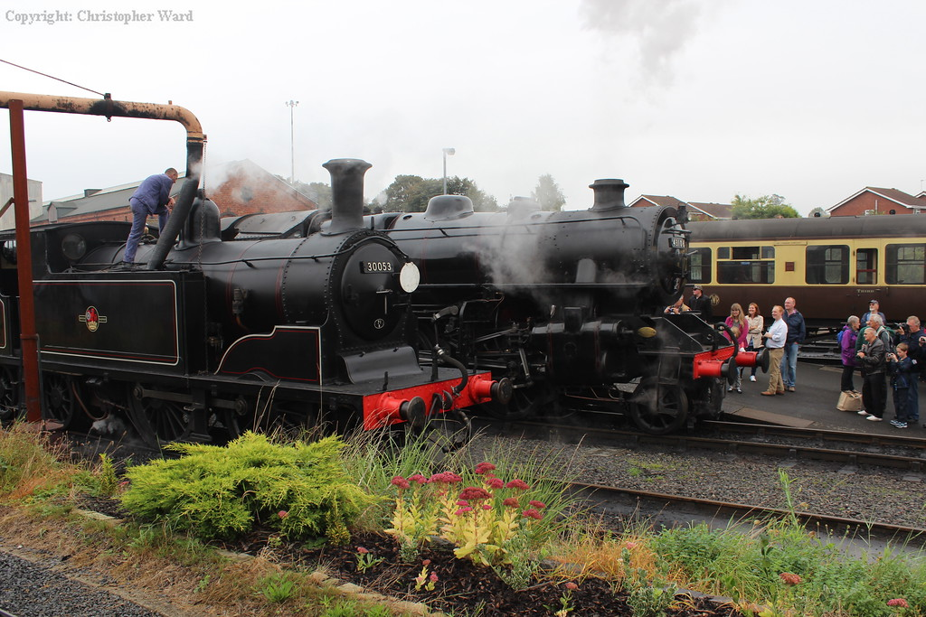 The M7 takes water as the Ivatt 4MT prepares to depart