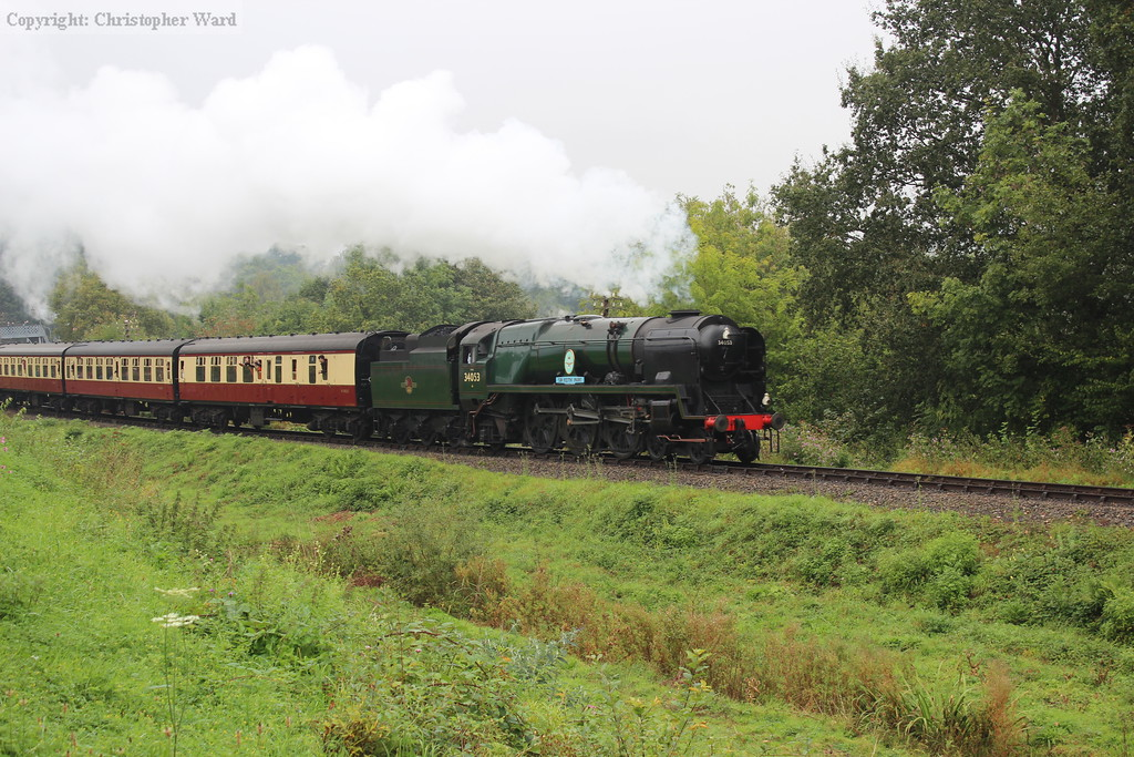 The Bulleid pacific gets into her stride pulling away from Highley
