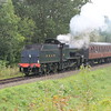 A whistle from the 7F as she passes the Engine House on the approach to Highley