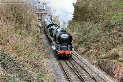 After crossing the points, the Bulleid is opened up to bring the train into the platform