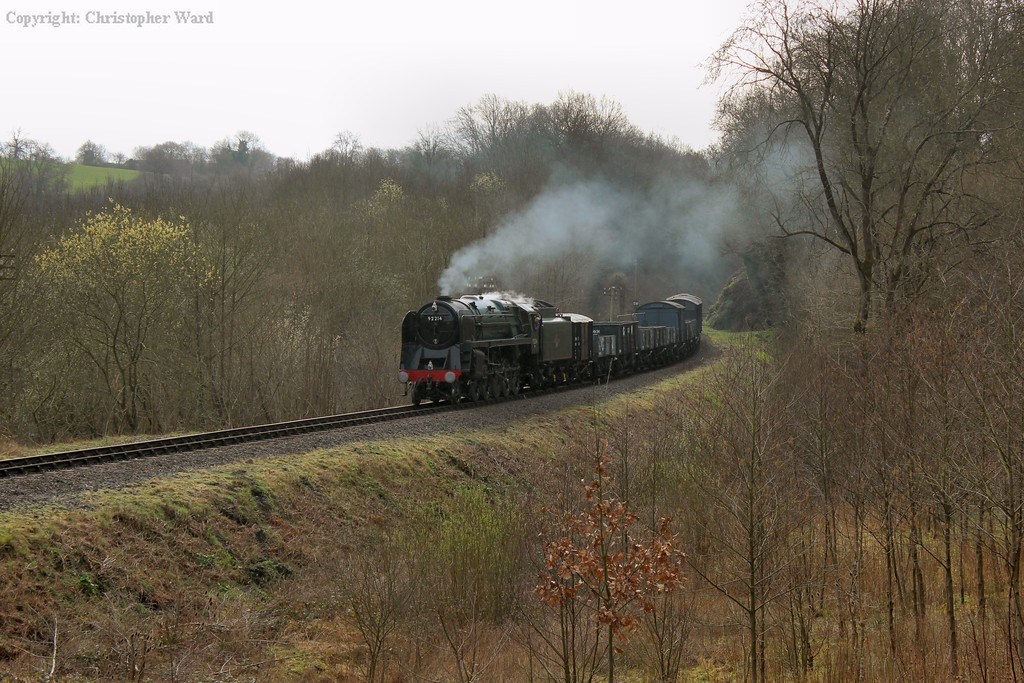 92214 brings the freight round the S curves and approaches Highley