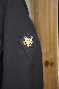 Patch sewn on military dress uniform