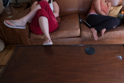 Two friends, both survivors of sex trafficking, relax on the couch to watch TV.