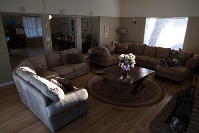 A serene living room absorbs the warmth of the late afternoon sun.