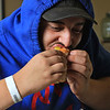 A new restaurant called Shake-N-Dog has opened in Leominster that serves up hot dogs and shakes. Enjoying his hotdog on Thursday is Mateo Fartado, 21, of Leominster. SENTINEL & ENTERPRISE/JOHN LOVE