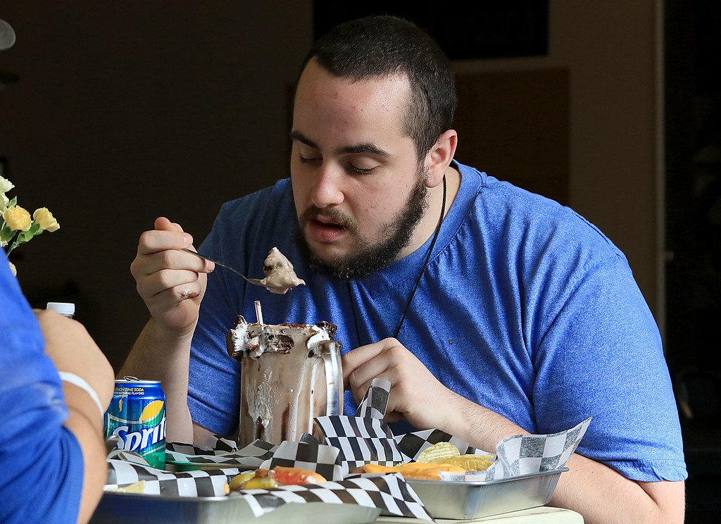 . A new restaurant called Shake-N-Dog has opened in Leominster that serves up hot dogs and shakes. Enjoying his milkshake on Thursday isShawn Bianchin, 21, of Leominster. SENTINEL & ENTERPRISE/JOHN LOVE