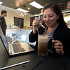 A new restaurant called Shake-N-Dog has opened in Leominster that serves up hot dogs and shakes. Nicole Rendon of Leominster tries a root beer float with her hotdogs during her lunch break on Thursday. SENTINEL & ENTERPRISE/JOHN LOVE