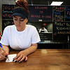A new restaurant called Shake-N-Dog has opened in Leominster that serves up hot dogs and shakes. Employee Adrianna Gonzalez, 20, waits for customers on Thursday in the restaurant. SENTINEL & ENTERPRISE/JOHN LOVE