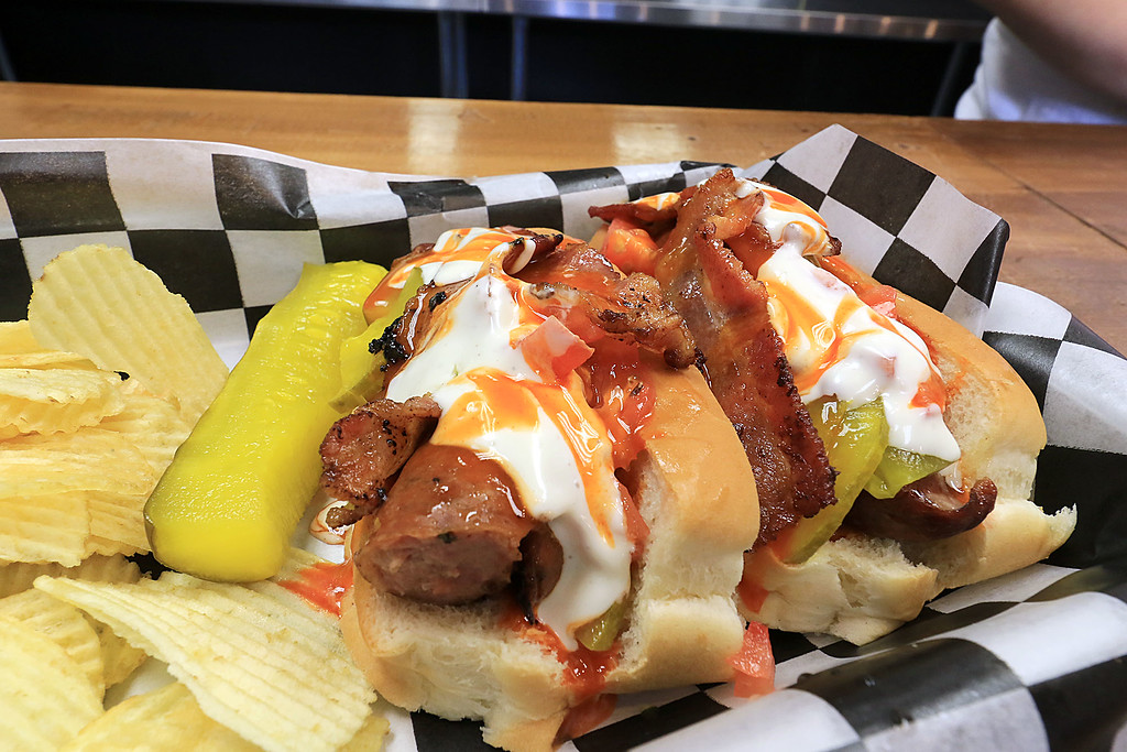 . A new restaurant called Shake-N-Dog has opened in Leominster that serves up hot dogs and shakes. Their buffalo kielbasa dog. It comes with bacon, onions, blue cheese, celery and carrots. SENTINEL & ENTERPRISE/JOHN LOVE