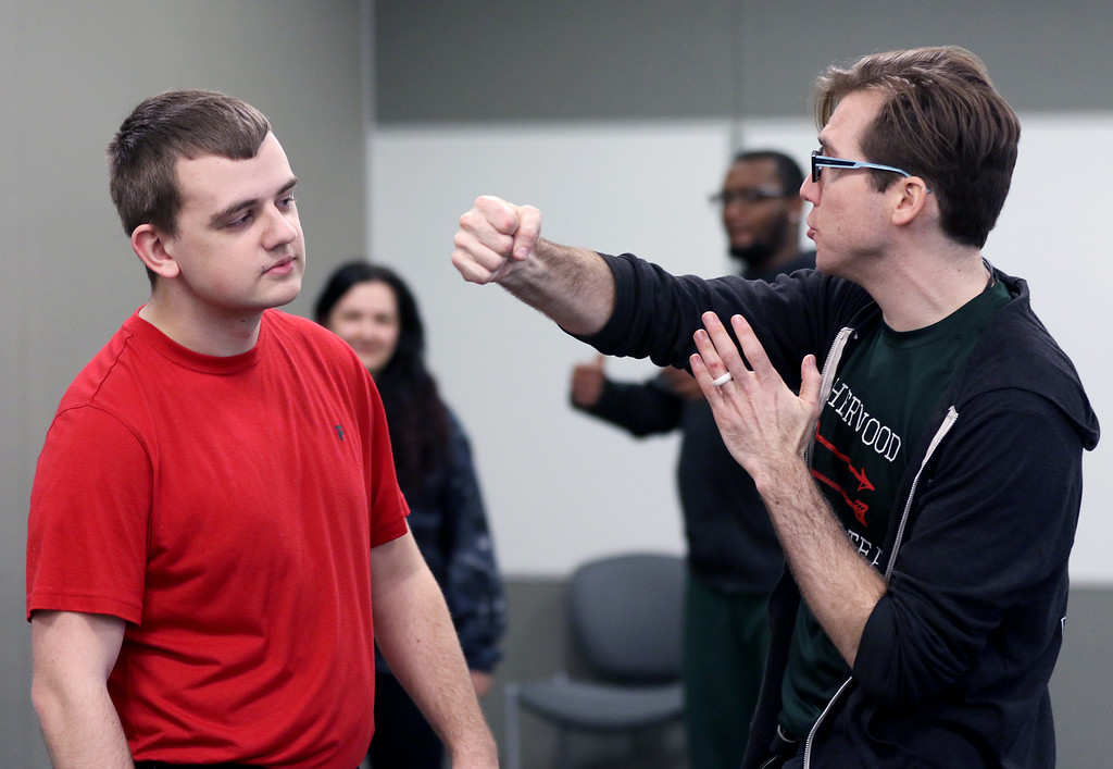 . Jonathan Tressler - The News-Herald. Lakeland Community College student Jonathan Simmons, left, reacts to being �punched� by the Ohio Shakespeare Festival�s Resident Fight Director and Production Manager Ryan Zarecki during one of the Shakespeare Stage Combat workshops held at Lakeland April 4.