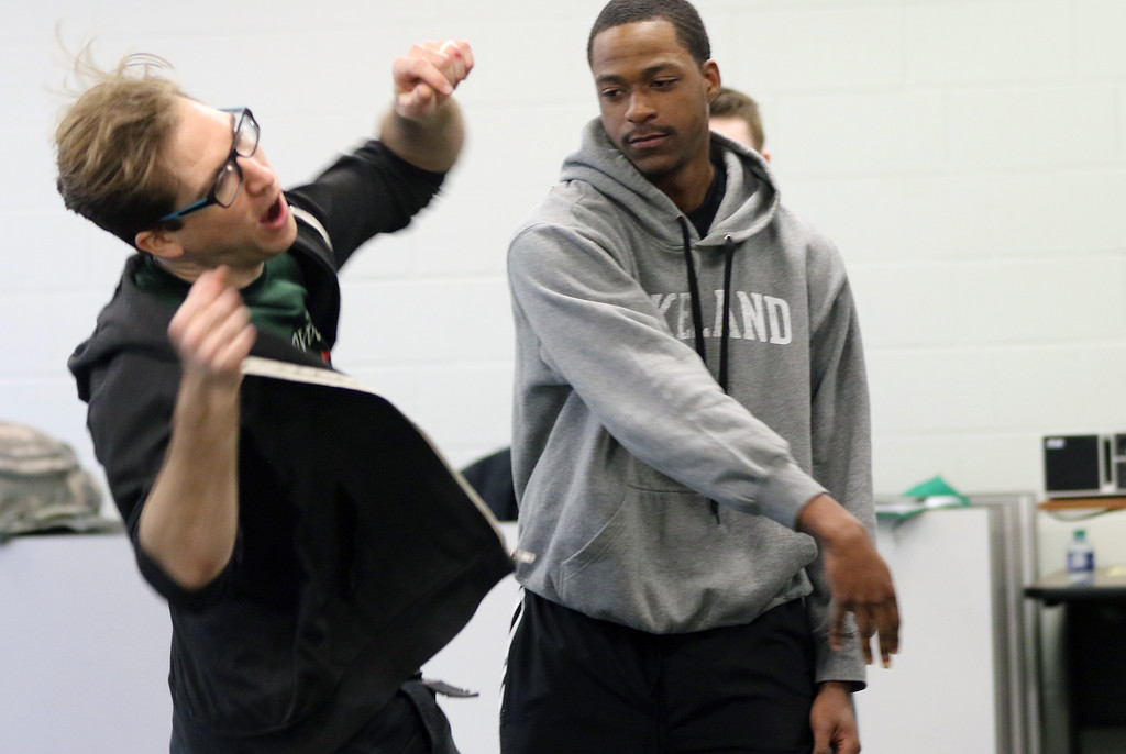 . Jonathan Tressler - The News-Herald. Ohio Shakespeare Festival crewmember Ryan Zarecki, left, reacts to being �pushed� by Lakeland Community College student and Mayfield Heights resident James Bennett during one of the Shakespeare Stage Combat workshops offered at Lakeland April 4.