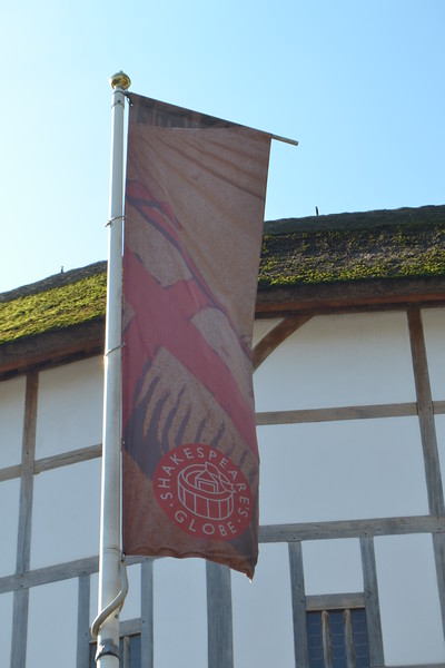 Faded banner outside the Globe Theatre, London