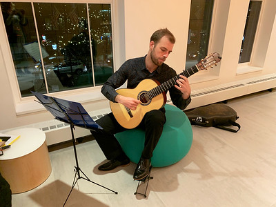 Carl Straussner of Cambridge serenades the guests