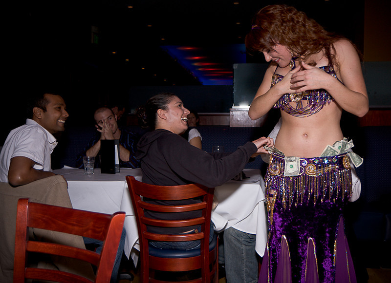 The belly dancer entertains the next table.