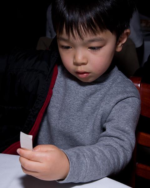 Cyrus studies his stickers.