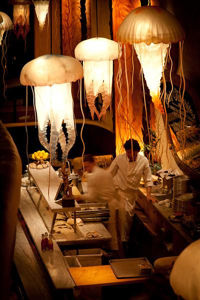 Jellyfish lighting hang above the dinner bar on the ground floor near the entrance.