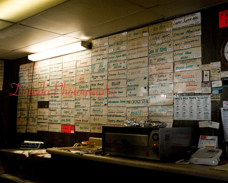 """Mac's Hoagies at Arch and Oak streets, Coal Township, was a popular take-out establishment known for its """"pizza macs"""" and dozens of hoagies that closed at the end of March 2015. The walls were covered with hundreds of signs of past-hoagies named after an assortment of things and people. The business was opened by Nancy and Jim McElwee in their apartment on Park Avenue in 1972 with a borrowed $5."""