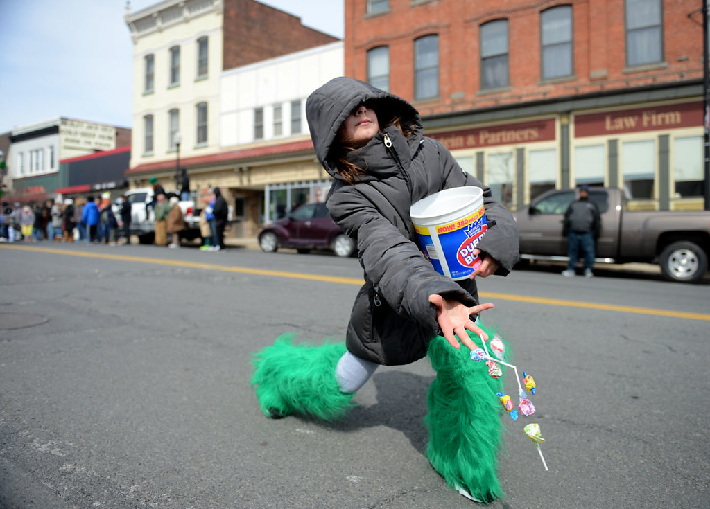 . Tania Barricklo-Daily Freeman Andrea Harris ,10, daughter of Allison Broker and Eric Harris of Esopus throws out candy to children along Broadway inKingston, N.Y. during the St. Patrick\'s Day Parade Sunday. Harris was in the parade with the Kingston Fire Department.