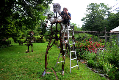 "Tania Barricklo-Daily Freeman  Dave Channon, the director and one of the of artist of the Shandaken Art Studio Tour, works on the head of his newest sculpture ""Roseud"" which will be on display at this year's tour. Channon's address is 247 Broadstreet Hollow, one of 5 artists on the same road."