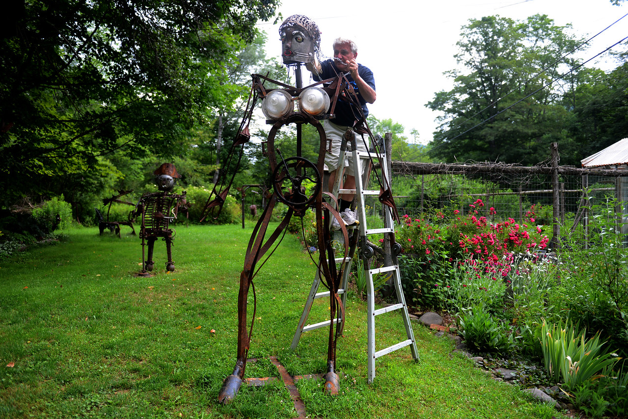 """Tania Barricklo-Daily Freeman  Dave Channon, the director and one of the of artist of the Shandaken Art Studio Tour, works on the head of his newest sculpture """"Roseud"""" which will be on display at this year's tour. Channon's address is 247 Broadstreet Hollow, one of 5 artists on the same road."""