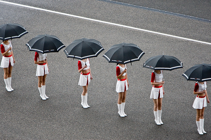 """Line up"" - 19 April. Models waiting to take their positions by the F1 cars"
