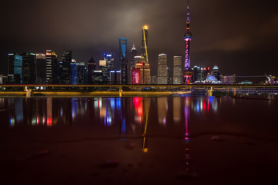 Reflection of Pudong skyline at night